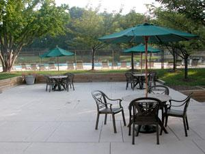 Outdoor picnic area next to the pool