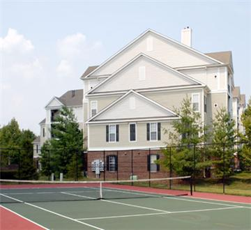 Full size tennis court with residence exterior