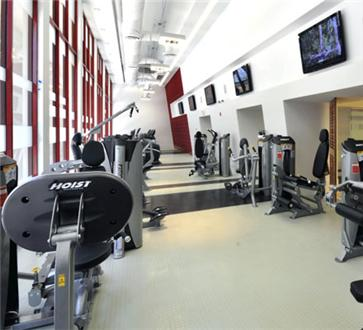 Fitness center includes flat screen TVs